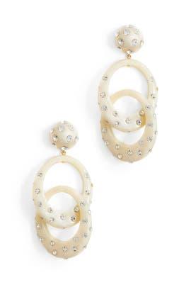 Interlocking oval hoops in ivory by Lele Sadoughi