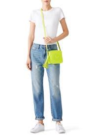 Neon Smiley Crossbody Bag by Anya Hindmarch
