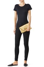 Gold Flex Clutch by Mackage Handbags